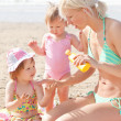 Happy young family at the beach — Stock Photo