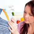 Stock Photo: Concentrated womsewing at home