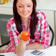 Stock Photo: Positive student with apple at home