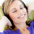 Relaxed womlisten to music with closed eyes — Stock Photo #10831370