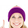 Joyful woman pointing upward — Stock Photo