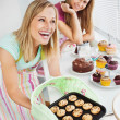 Laughing woman baking together — Stock Photo