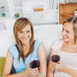 Royalty-Free Stock Photo: Captivating friends drinking wine in the living-room