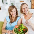 Stock Photo: Animated women eating salad