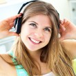 Lively young woman listen to music - Stock Photo