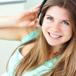 Smiling young woman listen to music - Stock Photo
