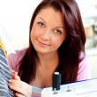 Attractive young caucasian woman sewing in the kitchen — Stock Photo