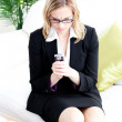 Angry businesswoman using her cellphone in the office — Stock Photo