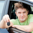 Animated caucasian man holding a car key — Stock Photo #10831975