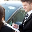 Confident businessman undersign a car contract — Stock Photo