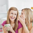 Close female friends talking together with a cup of coffee at ho — Stock Photo #10832043
