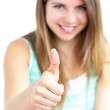 Positive woman with her thumb up to the camera — Stock Photo #10832186