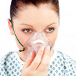 Female patient with an oxygen mask — Stock Photo #10832230