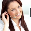 Charming young businesswoman wearing headphones smiling at the c — Stock Photo