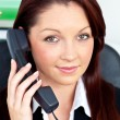 Positive businesswoman phoning in her office — Stock Photo