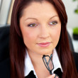 Concentratedl businesswoman holding her glasses sitting in her o — Stock Photo