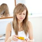 Diseased woman taking pills in her bathroom — Stock Photo