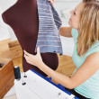 Serious young woman sewing clothes at home — Stock Photo #10833060