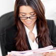 Stock Photo: Beautiful asibusinesswomreading newspaper in her offic