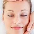 Portrait of a charming young woman receiving a head massage — Stock Photo #10833344