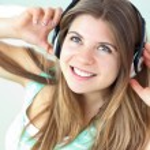 Cheerful caucasian girl listening to music sitting on a sofa — Stock Photo #10833411