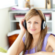 Stockfoto: Kind womlistening to music at home