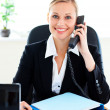 Radiant businesswoman talking on phone in her office — Stock Photo #10833904