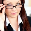 Stock Photo: Charismatic caucasibusinesswomholding her glasses