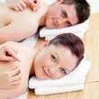 Charming caucasian couple receiving a back massage - Stockfoto