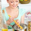 Stock Photo: Charming woman cooking sphaghetti in the kitchen