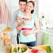Affectionate couple drinking wine in the kitchen — Stock Photo