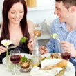 Young caucasian couple having dinner at home — Stock Photo