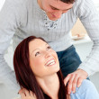 Lovely boyfriend massaging his girlfriend's shoulders on the sof — Stock Photo #10834242