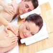 Stock Photo: Attractive young couple receiving back massage