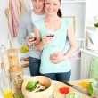 Stock Photo: Enamored couple drinking wine in kitchen