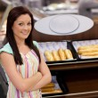 Self-assured female cook smiling at the camera — Stock Photo #10834342