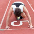 Athletic man waiting in starting block — Stock Photo #10834365