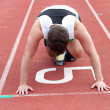 Athletic mwaiting in starting block — Stock Photo #10834365