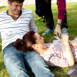Couple of bright students lying on the grass — Stock Photo #10834422