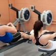 Stock Photo: Concentrated using rower