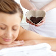 Bright woman lying on a massage table — Stock Photo #10834643