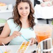 Caring mother preparing food for her lovely baby in the kitchen — Stock Photo