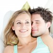 Portrait of a hugging couple sitting on a sofa in the living-roo — Stock Photo