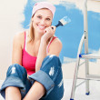 Cheerful woman painting a room — Stock Photo #10834727