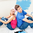 Relaxing couple relaxing after painting a room — Stock Photo
