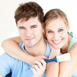 Smiling caucasian couple painting a room — Stock Photo #10834797