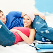 Happy young couple relaxing after painting a room — Stock Photo