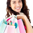 Brght woman holding shopping bags — Stock Photo