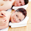 Bright caucasian couple receiving a back massage - Photo