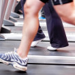 Close-up of the legs of an athletic young woman exercising on a - Stock Photo